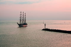 Tallship coming in to port. Tallship coming into port late summer evening Royalty Free Stock Photo