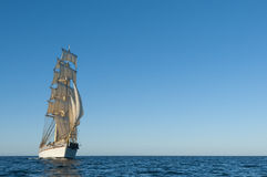 Tallship and horizon. Swedish brig Tre Kronor af Stockholm underway by sail in the middle of Baltic Sea. Free horizon and a light breeze Royalty Free Stock Photo