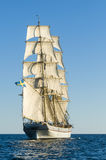 Tallship under sail. Swedish brig Tre Kronor af Stockholm underway by sail in the middle of Baltic Sea. Free horizon and a light breeze Royalty Free Stock Images