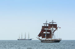 Tallships off Warnemünde during Hanse Sail 2014. To the left russian fullrigger Kruzenstern, in foreground british brig Eye of the Wind. Warnemünde Royalty Free Stock Image