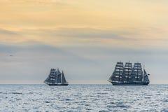 Tallships sailing at dawn. Three-masted Bulgarian barquentine Royal Helena and Russian four-master barque Kruzenshtern sailing during The Tall Ships´ Races Stock Images