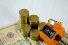 Tally counter or counting machine with 0000 number, coin and ban Royalty Free Stock Photo