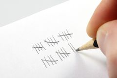 Tally marks and pen royalty free stock photos
