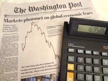 Tallying Losses. Photo of washington post newspaper and calculator on 8/5/11 at a home in washington dc.  The stock market took a dive on 8/4/11 owing to the Stock Photography