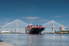 Talmadge Memorial Bridge and Container Ship in Savannah. October 1, 2016: Talmadge Memorial Bridge with Container Ship headed out to sea Royalty Free Stock Photo