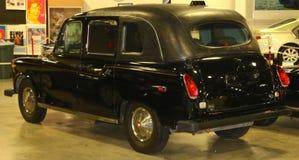 50-talmodellBlack Antique Taxi taxi Arkivfoto