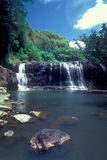 Talofofo Falls Guam. Talofofo Falls is a 30-foot waterfall in the Ugum River which cascades into a deep pool framed by steep bluffs and level rock ledges, and is royalty free stock photo