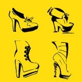 Talones de las mujeres zapatos y calzado elegantes Foto de archivo libre de regalías