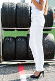 Talons hauts et pneu noirs d'emballage image stock