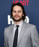 "Taylor Kitsch. Actor  Taylor Kitsch arrives on the red carpet for the New York premiere of ""The Normal Heart, "" at the Ziegfeld Theatre in New York City on Royalty Free Stock Photo"