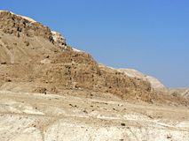 Talus slopes - Qumran mountains. Eroded and weathered debris or materials, known as scree or talus deposits, lie at the base of the cliffs in the desert region Stock Image