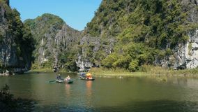 Panorama view of beautiful karst scenery, river and rice paddy fields. TAM COC, VIETNAM - DECEMBER 17, 2018: Panorama view of beautiful karst scenery, river and stock footage