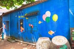 TAM THANH, TAM KY, VIETNAM - MAART 16, 2017: Geschilderde muur, Straatkunsten in Tam Thanh-muurschilderingdorp Royalty-vrije Stock Foto