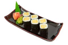 Tamago maki. Sushi on a plate isolated on white background stock photography