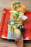 Tamago yaki with mushrooms and salmon skin. Royalty Free Stock Image