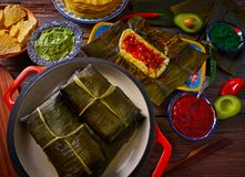 Tamale Mexican recipe with banana leaves. Tamale Mexican food recipe with banana leaves steamed Royalty Free Stock Images