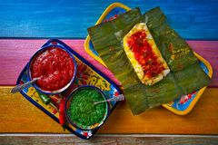 Tamale Mexican recipe with banana leaves. Tamale Mexican food recipe with banana leaves steamed Royalty Free Stock Image
