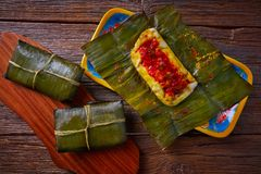 Tamale Mexican recipe with banana leaves. Tamale Mexican food recipe with banana leaves steamed Stock Photography