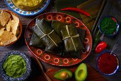 Tamale Mexican recipe with banana leaves. Tamale Mexican food recipe with banana leaves steamed Stock Photos