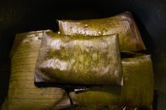 Tamale Mexican recipe with banana leaves. Tamale Mexican food recipe with banana leaves steamed Stock Images
