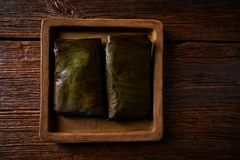 Tamale Mexican recipe with banana leaves. Tamale Mexican food recipe with banana leaves steamed Royalty Free Stock Photo