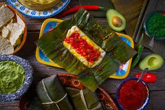 Tamale Mexican recipe with banana leaves. Tamale Mexican food recipe with banana leaves steamed Royalty Free Stock Photos