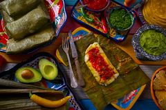 Tamale Mexican recipe with banana leaves. Tamale Mexican food recipe with banana leaves steamed Stock Photo