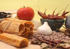 Tamales. With Peppers and Beans on Yellow Background Stock Image