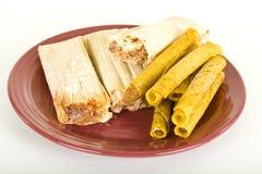 Tamales y Tacos congelados en la placa Imagenes de archivo