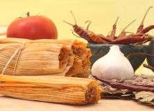 Tamales on Yellow Background. Tamales With Garlic, Beans and Tomato on Yellow Background Royalty Free Stock Photo