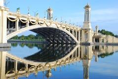 Taman Seri Empangan, Putrajaya, Malaysia. Reflection of Seri Geminlang Bridge at Taman Seri Empangan, Puttajaya, the federal administrative centre of Malaysia Royalty Free Stock Photos