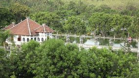 Taman Ujung water palace, which is situated near the ocean and decorated by beautiful tropical garden, Bali, Indonesia. stock footage