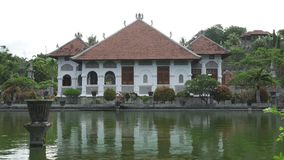 Taman Ujung water palace, which is situated near the ocean and decorated by beautiful tropical garden, Bali, Indonesia. Taman Ujung water palace, which is stock footage