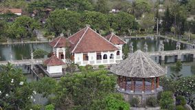 Taman Ujung water palace, which is situated near the ocean and decorated by beautiful tropical garden, Bali, Indonesia. stock video