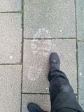 Tamanho deles pés fotografia de stock royalty free