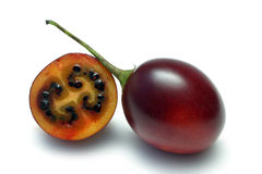 Tamarillo. Whole and halved isolated on white Stock Photo