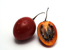 Tamarillo fruits. A full and a half tamarillo fruit, white background stock image