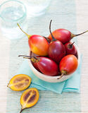 Tamarillo fruits with slice on blue napkin. Outdoor background Royalty Free Stock Photos
