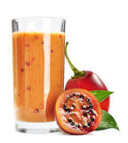 Tamarillo juice. In glass with fresh tamarillo fruits  on white background Royalty Free Stock Photos