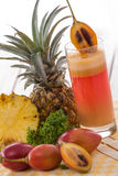 Tamarillo and pineapple mix smoothies Royalty Free Stock Photo