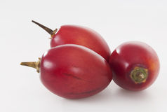 Tamarillo. Tasty and ripe tamarillo on white Stock Photo