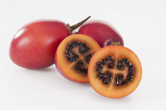 Tamarillo. Tasty and ripe tamarillo on white Royalty Free Stock Photos