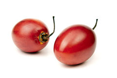 Tamarillo. Two whole ripe and juicy tamarillo on white background Stock Photos