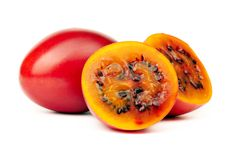 Tamarillo. Whole and cut half-and-half on white background Stock Image