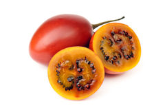 Tamarillo. Whole and cut half-and-half on white background Royalty Free Stock Photo
