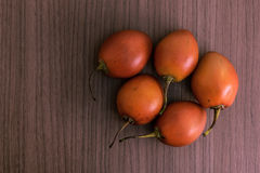 Tamarillo on wood Royalty Free Stock Images