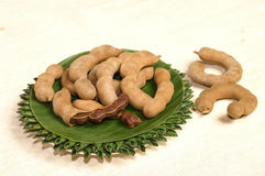 Tamarind fruit serve on plate decorate by banana leaf Stock Photography