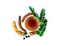Tamarind juice in a glass and tamarind leaves stock images