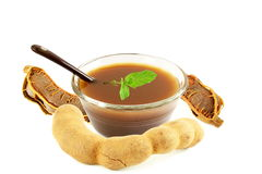 Tamarind water juice  paste or soup in bowl with mint Royalty Free Stock Photo