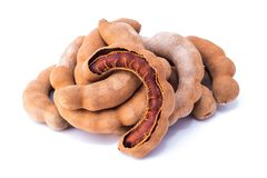 Tamarind with  on a white background. Tamarind - Sweet ripe tamarind with  on a white background. Closeup Stock Photography